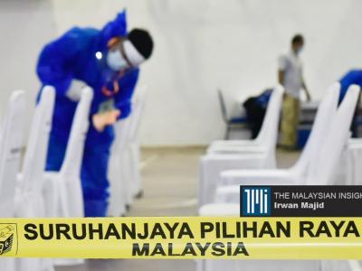 这是我国首次在疫情下举行州选举,为了确保疫情不会蔓延,在提名日前做好消毒等防疫工作。(摄影:Irwan Majid)