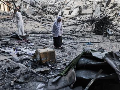 Palestinians walk after performing Eid al-Fitr prayers amid debris near the al-Sharouk tower, which housed the bureau of the Al-Aqsa television channel in the Hamas-controlled Gaza Strip, after it was destroyed by an Israeli air strike, in Gaza City. Israel faced an escalating conflict on two fronts, scrambling to quell riots between Arabs and Jews on its own streets after days of exchanging deadly fire with Palestinian militants in Gaza. – AFP pic, May 15, 2021.