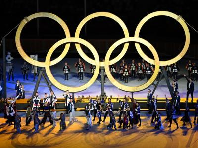 Performers assemble the Olympic Rings during the opening ceremony of the Tokyo Olympics, at the Olympic Stadium in Tokyo. – AFP pic, July 24, 2021.