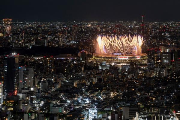 Fireworks light up the sky over the Olympic Stadium during the opening ceremony of the Tokyo Olympics. – AFP pic, July 24, 2021.