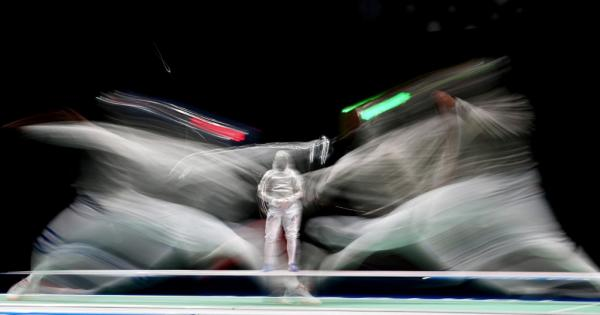 Italy's Luca Curatoli (L) competes against Romania's Iulian Teodosiu in the men's sabre individual qualifying bout during the Tokyo 2020 Olympic Games at the Makuhari Messe Hall in Chiba City, Chiba Prefecture, Japan. – AFP pic, July 25, 2021.