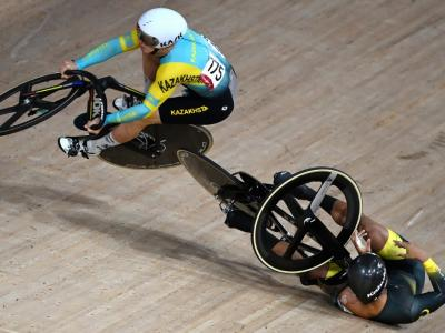 Kazakhstan's Sergey Ponomaryov (left) crashes with Malaysia's Muhammad Shah Firdaus Sahrom in the men's track cycling keirin first round heats at Izu Velodrome in Izu, Japan. – AFP pic, August 8, 2021.