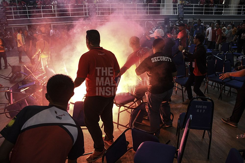 Troublemakers have ignited two flares, thrown chairs and flung shoes and slippers on stage when Dr Mahathir Mohamad was speaking. The fracas forced organisers have escorted Dr Mahathir and other VIPs out of the hall immediately. – The Malaysian Insight pic by Nazir Sufari, August 13, 2017.