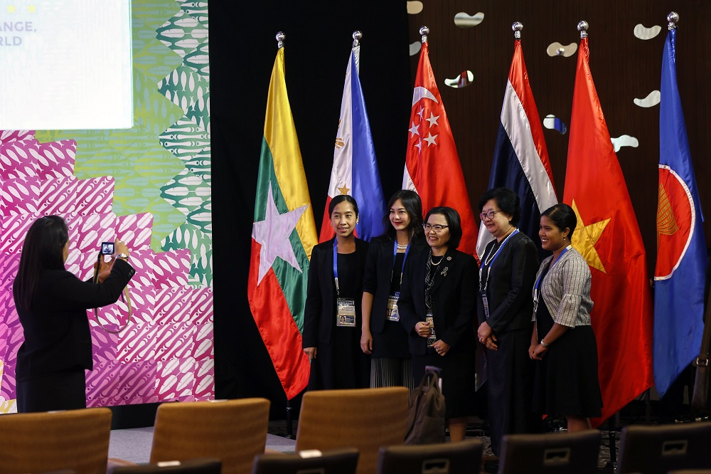 Delegates take souvenir photographs beside Asean country flags during the opening ceremony of the 49th Asean Economic Ministers Meeting and Related Meetings in the Philippines, today. Philippine President Rodrigo Duterte urged Asean trade officials to remain committed in taking the RCEP agreement to a substantial conclusion. – EPA pic, September 7, 2017.