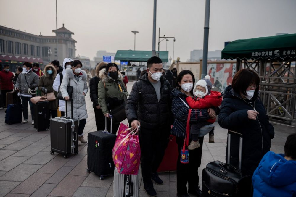 Commuters wearing masks while queuing to take a taxi at the Beijing railway station. China has imposed total and partial lockdowns on 15 cities in a bid to stop the spread of a deadly virus which began in Wuhan. – AFP pic, January 29, 2020.