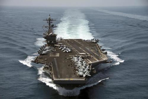 US navy evacuates virus-stricken aircraft carrier