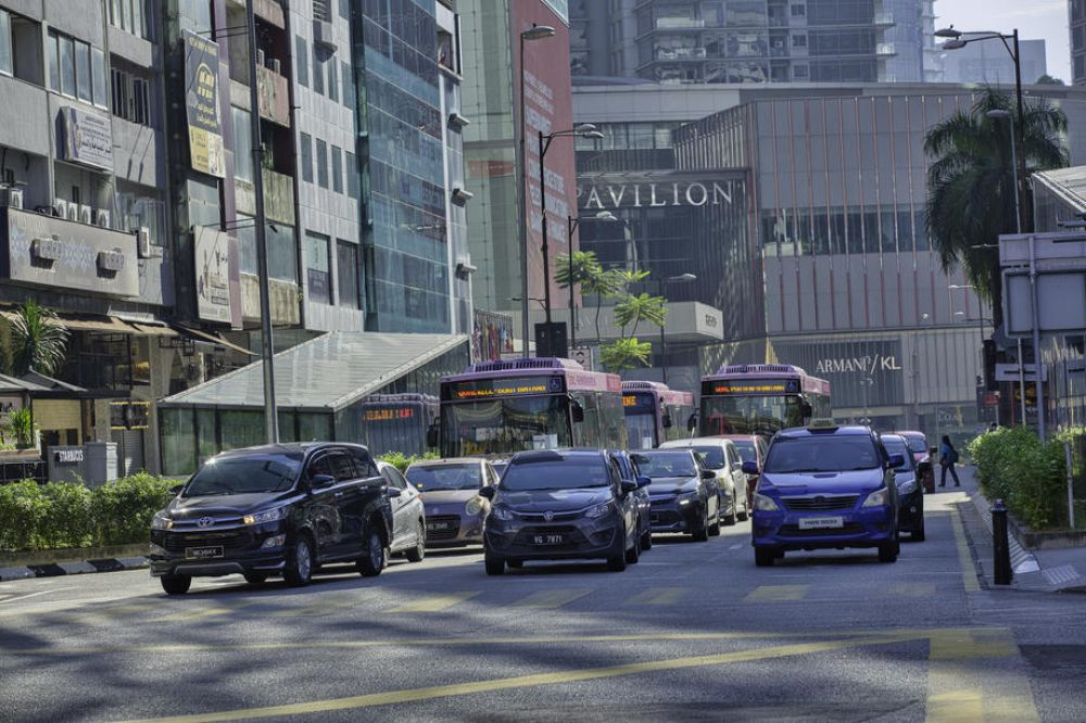 Traffic at Bukit Bintang in Kuala Lumpur on Monday, the first day of the relaxation of the MCO. According to reports, the country lost about RM63 billion since the movement-control order was imposed on March 18. – EPA pic, May 7, 2020.