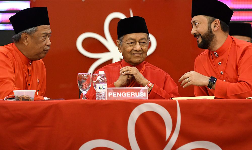 (From left) Muhyiddin Yassin, Dr Mahathir Mohamad and Mukhriz Mahathir at Bersatu's first AGM in Shah Alam, Selangor, on December 30, 2017.  A faction within Bersatu are hoping that the three co-founders of Bersatu will reconcile. – The Malaysian Insight file pic, May 22, 2020.