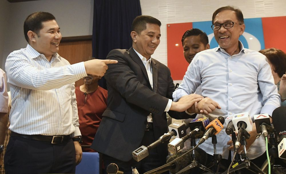 (From left) Rafizi Ramli, Mohamed Azmin Ali and Anwar Ibrahim in happier times on September 21, 2018. Azmin has since left the party to join forces with Prime Minister Muhyiddin Yassin. – The Malaysian Insight file pic, May 29, 2020.