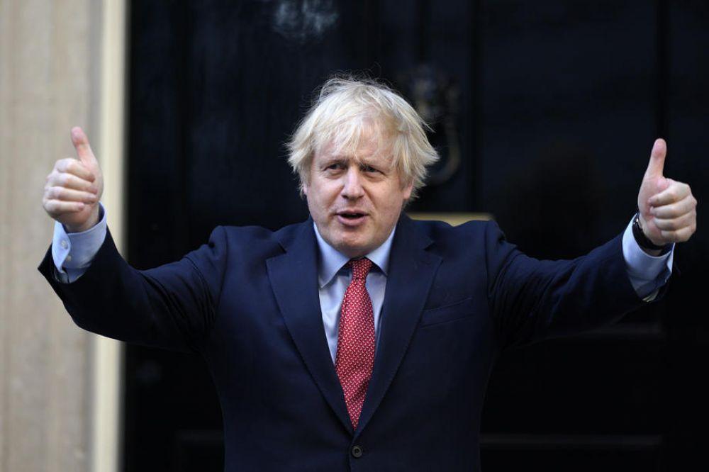 英国首相约翰逊公开表示中国如果坚持在香港颁布《国安法》,伦敦或将修改其移民政策,允许拥有BN(O)身份的香港人享有英国公民权。(图:欧新社)