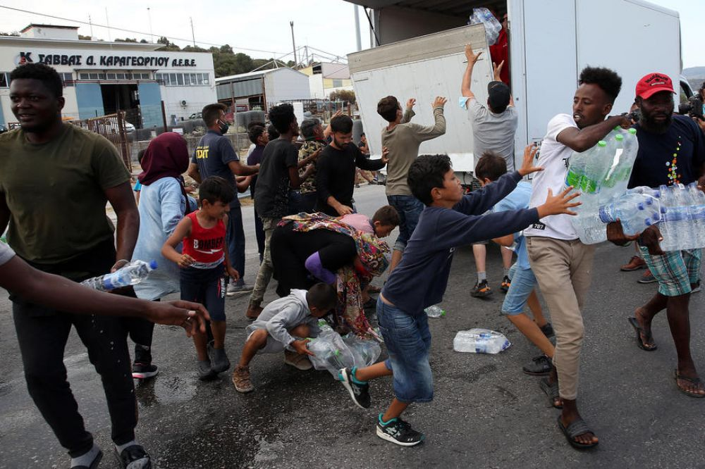 Greece opens new camp for Moria migrants but thousands refuse to enter