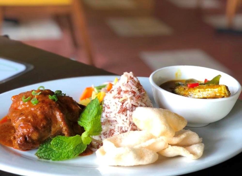 Nasi dagang with ikan tenggiri curry and ayam percik. The Malaysian Insight pic, November 28, 2020.