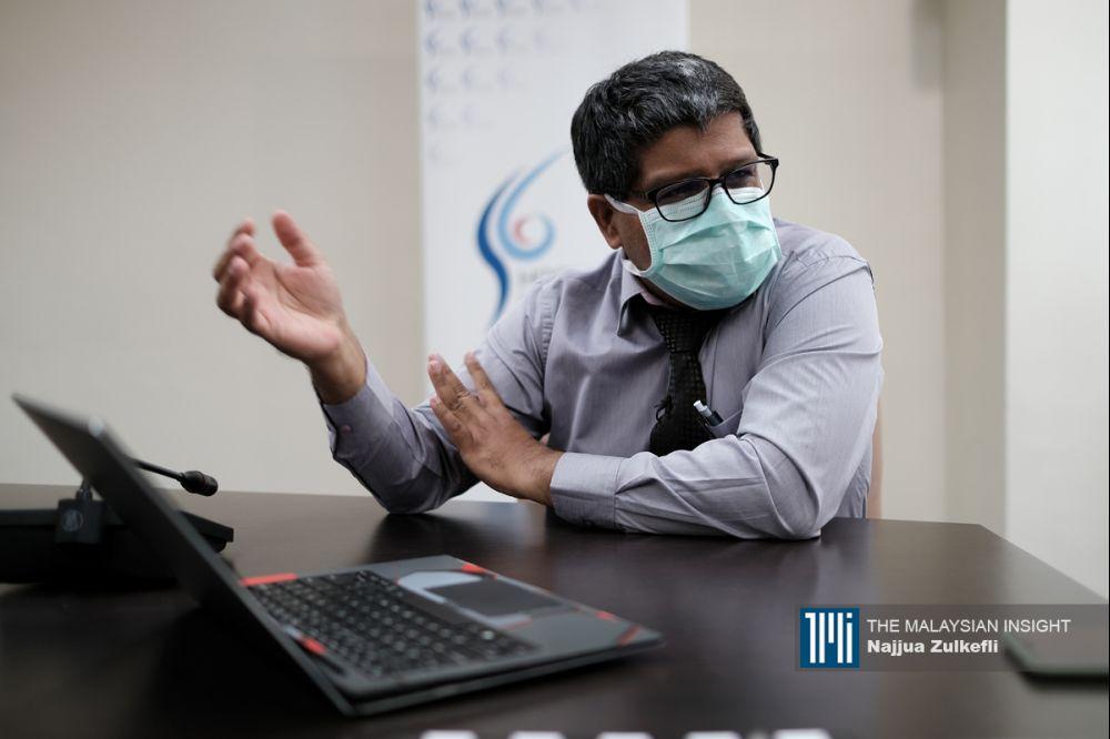 苏勒斯医生在医院领导及负责应对新冠肺炎疫情一年后,渴望回到治理曾是其最大问题的爱滋病、肺痨病和骨痛热症的日子。(摄影:Najjua Zulkefli)